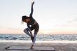 Leinwanddruck Bild - Portrait of a attractive young woman doing yoga