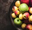 Fresh organic autumn apples in a bowl