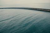 A rocky jetty on a very calm sea