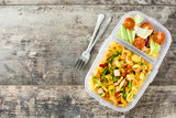Lunch box with healthy food ready to eat.`Pasta salad on wooden table. Top view. Copyspace - 217137125