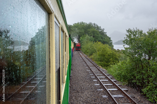 Riding on the steam train of Llanberis Lake Railway on rainy day in summer - 4