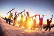Leinwandbild Motiv Happy friends at ski resort having fun sunset