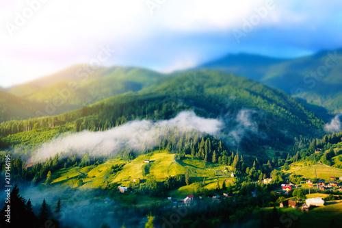 Foto Spatwand Blauwe hemel Beautiful sunny day mountain summer landscape. Beauty summer nature world. Tilt Shift blur effect.