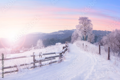 Leinwandbild Motiv Beautiful winter nature landscape, amazing mountain view of sunset. Scenic image of snowy woodland.