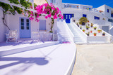 Traditional houses, wind mills and churches in Ios island, Cyclades, Greece. - 217146935