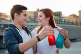 So thirsty. Happy positive couple drinking juice while walking around the city - 217162516