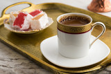 Vintage cup of turkish coffee and turkish delights served in bronze tray on marble - 217170186