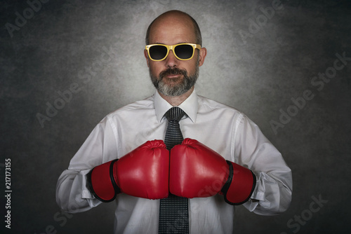 Businessman In red Boxing Gloves