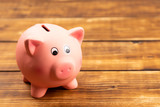 pink piggy bank on wooden background - 217218304