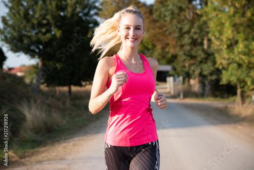 Plexiglas Hardlopen Junge Frau beim Joggen