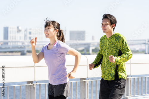 Foto Spatwand Hardlopen young asian couple jogging