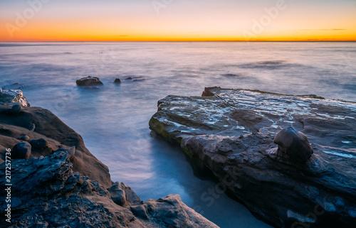 Canvas Zee zonsondergang Rocks and Waves