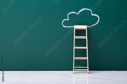 Wooden Ladder Leaning On Green Blackboard - 217261960