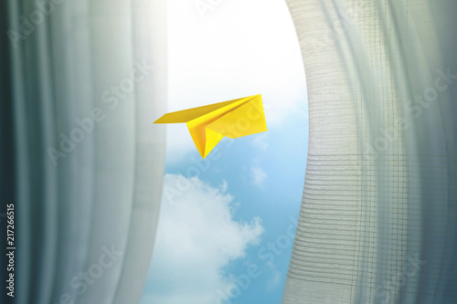 Foto Murales Travel, Freedom and Imagination Concept. Paper Airplanes Flying Through Window and Curtain, Selective Focus. Blue Sky as Outside View