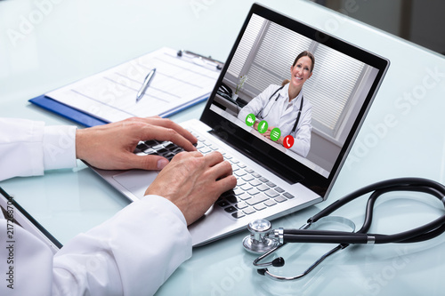 Doctor Video Conferencing On Laptop