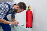 Man Checking Symbol On Fire Extinguisher