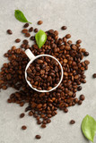 Coffee beans in espresso white cup