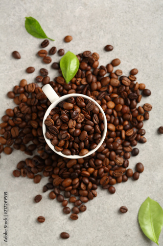 Wall mural Coffee beans in espresso white cup