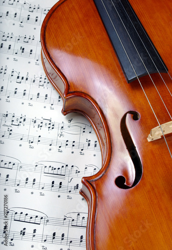 Violin on sheet music. close up. top view. - 217270186