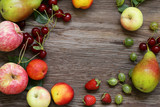 different berries and fruits on a wooden table - 217270970