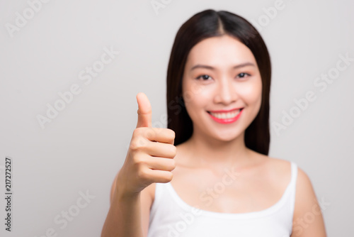 Aluminium Spa Young Asia woman with smiley face Thumps up gesture, isolated on white background.
