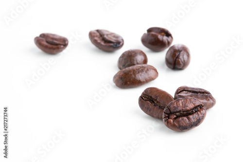 Roasted coffee beans isolated on pure white background for content using.
