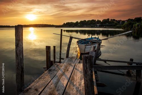 Aluminium Pier sunset with a boat in Croatia