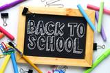 Back to School Text. Wooden Frame Blackboard Between School Stationary