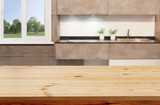 Wood table top on blur kitchen window background, banner - can be used for montage your products or foods - 217291133