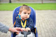 child boy sitting on bicycle chair