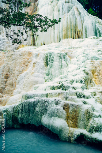 Fotobehang Toscane Hot spring. Hot water is floating over white termal limestone cliffs. Bagni San Filippo, Italy
