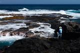 Pêcheur regardant l'océan indien à la réunion