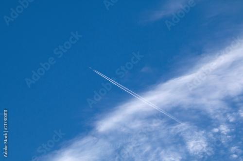 Foto Murales Plane, contrail and Cirrocumulus Clouds
