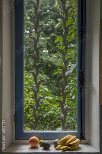 Foto Murales Fruits and kitchen window with garden view