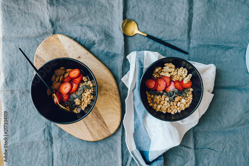 granola with strawberries - 217304109