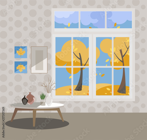 Window with a view of yellow trees and flying leaves. Autumn interior with a coffee table, vases, pictures on grey wallpaper. Sunny good weather outside. Flat cartoon style vector illustration. - 217307369