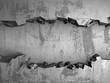 Dark cracked broken hole in concrete wall. Grunge background - 217314944