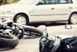 Dead motorcyclist on the road after traffic incident with a car - 217319522