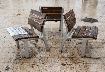 Benches on wet tiles. © German S