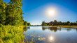 Leinwanddruck Bild - Summer landscape with trees, meadows, river and bright sun