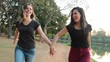 LGBT couple runing holding hands