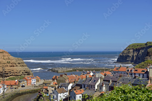 Overlook of the colorful fishing village of Staithes in North Yorkshire, England