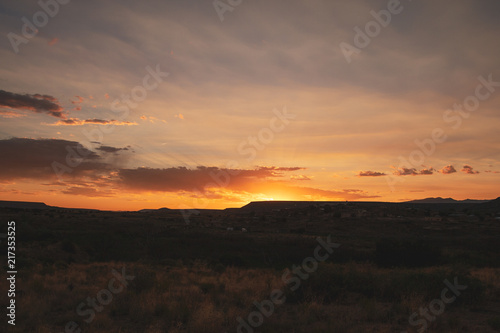 Canvas Route 66 Beautiful vibrant countryside sunset over hillside in New Mexico along the US route 66, USA.