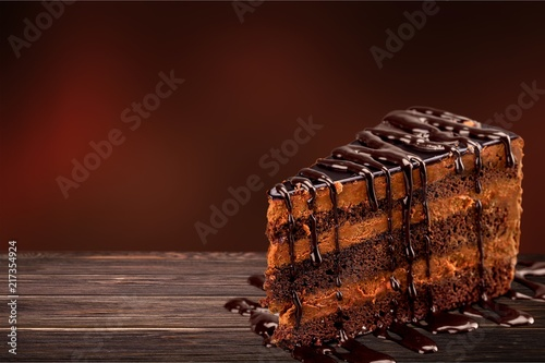 Leinwanddruck Bild Chocolate cake with chocolate creame isolated on