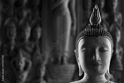Foto Spatwand Boeddha buddha statue face in the temple - monochrome
