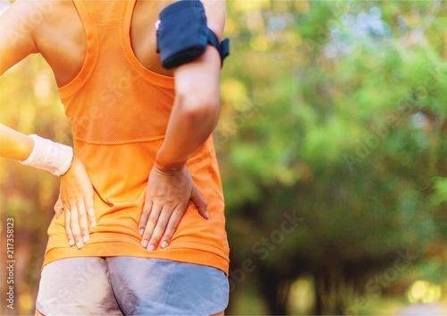 Foto Murales Young beautiful sporty woman outdoors