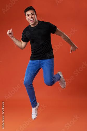 Foto Murales Casual man in air jumping