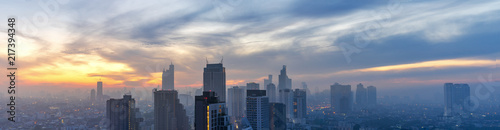 panorama of early morning cityscape with sunrise and high mist and cloudscape