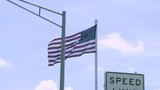 The American flag blows in the wind in slow motion - 217397542