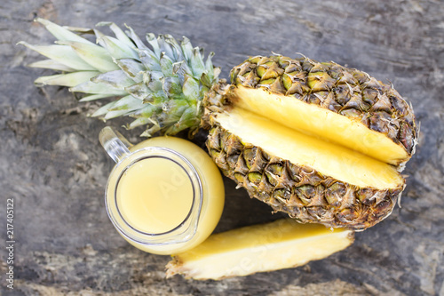 Aluminium Sap pitcher of pineapple juice on rustic wood, diet and healthy drink concept
